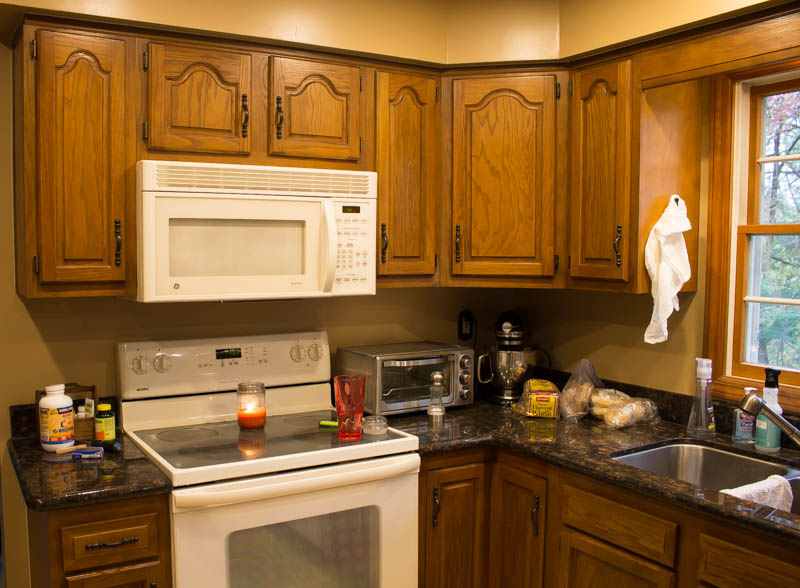 Oak Kitchen Cabinet Makeover using Alkyd Paint • Roots